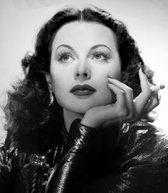 """She was born Hedwig Eva Maria Kiesler on November 9, 1914 in Vienna, Austria. Once in Hollywood, she officially changed her name to Hedy Lamarr and starred in her first Hollywood film, Algiers (1938), opposite Charles Boyer.  As if being a beautiful, talented actress was not enough, Hedy was also extremely intelligent. This combined with her acting talent and star quality made """"the most beautiful woman in film"""" one of the most interesting women in the movie industry."""