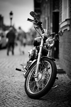 Nice black & white shot of bike. Not sure what make or model.