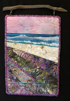 Casting Shadows.  Small beach scene hung from found drifwood by Eileen Williams