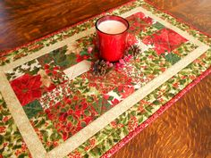 Handmade Quilted Christmas Table Runner/Table Topper/Fabrics with red, green and metallic gold by RubysQuiltShop on Etsy
