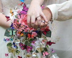 Hand created wedding bouquet with butterflies.