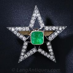 Victorian Emerald and Diamond Star Brooch - this sparkling emerald centered, five-pointed star brooch. 1.00 carat of glittering diamonds frame a bright green 1.35 carat emerald glowing from within a gold bezel mounting. The pin mechanism screws off to allow it to be worn as a pendent. 1 1/4 inch across.