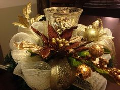 Items similar to Gold Deco Mesh Centerpiece with Mercury Glass Candle Holder on Etsy Christmas Swags, Xmas Wreaths, Christmas Flowers, Noel Christmas, Christmas Ornaments, Centerpiece Christmas, Christmas Flower Arrangements, Easy Holiday Decorations, Xmas Crafts