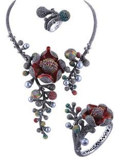 Silver, gemstone, and pearl parure by Pochai.