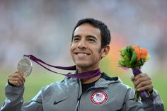 US silver medalist U.S. runner Leonel Manzano celebrates on the podium of the men's 1500m at the athletics event of the London 2012 Olympic Games on August 8, 2012 in London.