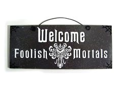 Welcome Foolish Mortals sign. Haunted Mansion.