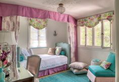 Sweet girls bedroom. I like how the curtains add a dramatic/royal look to the room. They would also be a great way to add privacy (shared bedroom) or to create a private nook. Love the painted ceiling too.