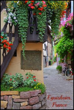 Equisheim is a small and colorful French village in the Alsace wine region of France. Charm exudes from this adorable medieval town.