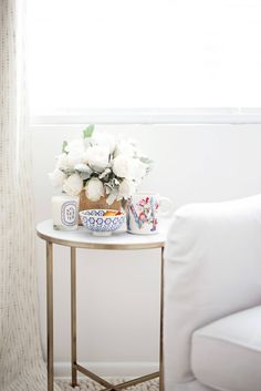 quiet mornings at home- marble side table with flowers and coffee