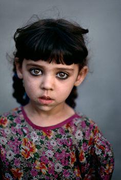 Girl in Kandahar orphanage, Afghanistan.  Photography by Steve McCurry