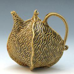 Carved porcelain teapot in olive green celadon