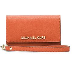 Leather phone wristlet for IPhone 5 This accessory knows how to multitask. Enclosed within the sleek Saffiano leather exterior are a variety of card slots, pockets and a special compartment to store your phone. Toss it in your go-to tote, or let it shine solo as a compact clutch. Michael Kors Accessories