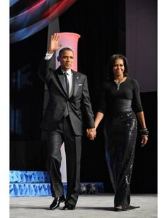 POTUS and FLOTUS both shine at the Congressional Black Caucus Foundation Annual Phoenix Awards. The First Lady repeats her Michael Kors-designed fishtailed and embellished skirt with a Peter Soronen belt. Effortlessly glam.AFP