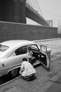 Available for sale from Magnum Photos, Erich Hartmann, Father and son on streets under the Brooklyn Bridge. New York City, USA. Urban Photography, Street Photography, White Photography, Erich Hartmann, Brooklyn Bridge New York, Black And White Aesthetic, The New School, Magnum Photos, Photo Essay