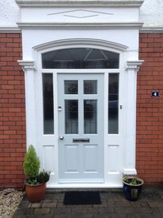 Traditional front door - light coloured Frenchay with sidelights and toplights