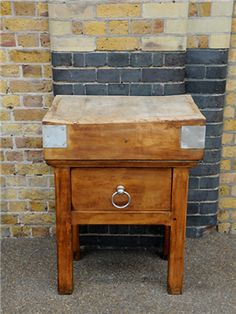 Mid-century butcher block table. Unusual single stand model. Drawer with impressive bull-ring handle.  origin: France  year: 1950  dimensions: width: 70cm; height: 90cm; depth: 50cm
