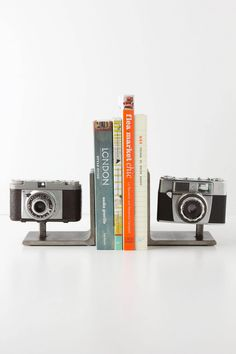 Vintage Camera Bookends - Anthropologie.com  Could make this with old cameras