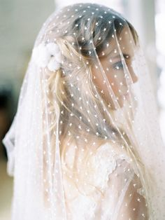 Romantic bridal look. Swiss dot wedding veil and lace wedding dress.