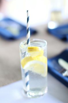 nautical #wedding drink idea - navy and white striped paper straws, slice of lemon for a splash of yellow