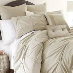 Create a luxe retreat in your master suite or guest room with this lovely comforter set, showcasing chic tufted details and a neutral sand-hued palette....