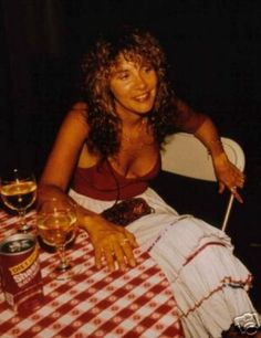 Stevie  ~ ☆♥❤♥☆ ~   looking gorgeous and tanned in a red body suit and a white tiered skirt trimmed in red, sitting around at a private function, where co-incidentally the checkered table cloth is also red and white