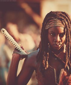 Michonne, from the Walking Dead. Now this gal is badass!!!