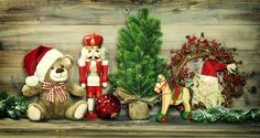 Stock image of 'Christmas decoration. Vintage toys Teddy Bear, rocking horse and Nutcracker. No name mass production ware. Retro style toned photo with vignette'