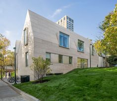 UPenn has added a new centre for international affairs to its campus, extending a small cottage built in 1851 with an angular stone-clad form.
