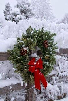 Christmas Wreath on Snowy Fence