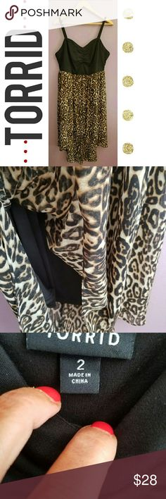 Torrid Cheetah Print Sun Dress NWOT This a re-Posh. Over never worn it. Seller stated it was a 16, but it's an 18/20 and doesn't fit me. Beautiful high - low dress with body con style built-in slip. Zero flaws Torrid Dresses