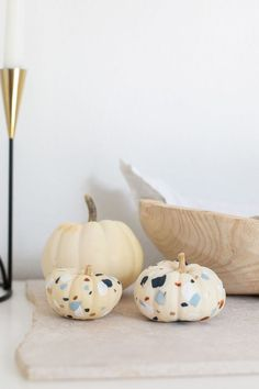 If you don't love turning over you home to spooky decor each October, try these on-trend pumpkin decorating ideas that don't scream Halloween.