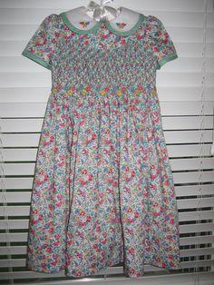 Liberty of London smocked dress with embroidery.  Designed by Gail Doane.  I love Liberty fabrics!