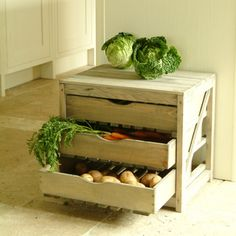 Having trouble getting the condo board to approve your plans for a root cellar? Fear not, organic food loving urbanite, this lovely pine unit from Garden Trading *http://www.gardentrading.co.uk/kitchen/storage/vegetable-store.html) has three drawers to help you separate your veggies for storage.   And what good is a vegetable store without vegetables? Get your organic grocery delivery scheduled today!  www.organicslive.com