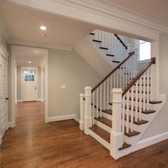 The beautiful U-shaped stair has hardwood treads and handrails with painted white risers, newel post and pickets.