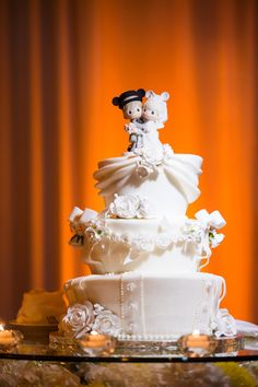 How cute is Ashlyn and Brandon's cake at their Disney's Fairy Tale Wedding reception?