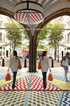 Mirrors have historically been linked with the concept of infinity which calls to mind the infinitely repeating mathematical patterns ...  Design Studio Russ + Henshaw Project: Tile Mile - site-specifi installation beneath the two, six-metre high arches of St John's Gate.