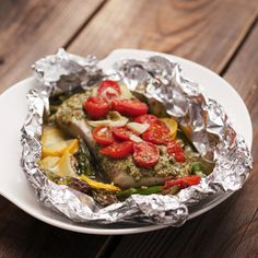 No Mess Summer Fish Packets with Pesto take advantage of seasonal produce combined with tasty fish fillets. With little prep and limited post-party clean-up, this healthy dish can be baked or grilled – perfect for summer entertaining and is easy-to-make.