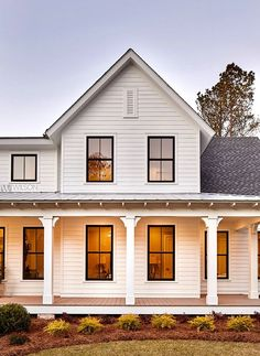 Do you love Farmhouse Exterior Design? Do you want to change the look of your home to become a Modern Farmhouse Exterior? Home exterior is the first thing that will be seen by others, so make your home's exterior become… Continue Reading → White Farmhouse Exterior, Farmhouse Windows, Farmhouse Design, Rustic Farmhouse, Farmhouse Style, Farmhouse Front Porches, Farmhouse Lighting, Farmhouse Ideas, Café Exterior