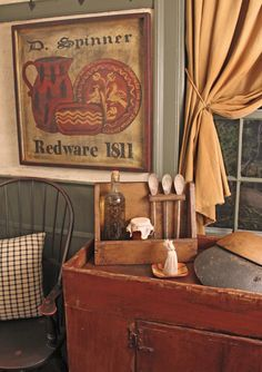 Prims...wooden redware sign, old cupboard & spoon rack & the curtains.
