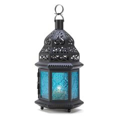 Ocean blue is the color of serenity, beautifully showcased in this intricate metalwork Moroccan lantern. Ornate cutouts allow a candle's golden light to provide