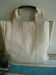 canvas bag with leather handles and bottom