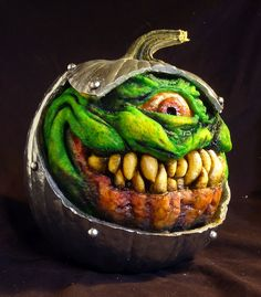 These Terrifying Pumpkins Bring Jack O'Lanterns to a Grotesque New Level John O'Neill carving. Reminds me of Slimer!