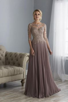 Jacquelin Bridals Canada - 17860 - Mother of Bride - Full-length gown with beaded lace on net bodice and 1/2-length sleeves accented by a drop waist. The Pleated skirt is made from poly chiffon. Sheer back with center zipper and sweep train.