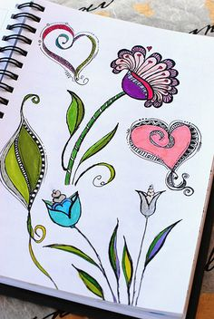 "Practicing various flower, leaf, and heart designs from ""Zenspirations, Letters & Patterning"" by Joanne Fink."