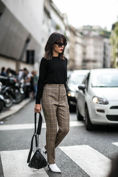 Look to Style Heroine's Evangelie Smyrniotaki at MFW and make tailoring your new off-duty go-to. Pair Balenciaga's hound's-tooth trousers with a simple knit fro street style ease. Shop the look at MATCHESFASHION.COM http://www.matchesfashion.com/products/Balenciaga-Hound%27s-tooth-wool-stirrup-trousers-1065996