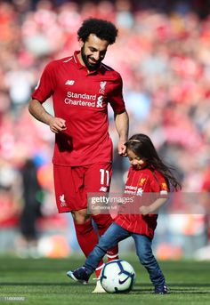 Mohamed Salah of Liverpool plays football on the pitch with his child after the Premier League match between Liverpool FC and Wolverhampton Wanderers at Anfield on May 2019 in Liverpool, United. Get premium, high resolution news photos at Getty Images Liverpool Football Club, Liverpool Fc, Mohamed Salah Liverpool, Egyptian Kings, Mo Salah, Club World Cup, World Cup Winners, You'll Never Walk Alone, Zinedine Zidane