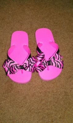 Cheap $1 flip flops added ribbon to them. Cute summer shoes for a little girl