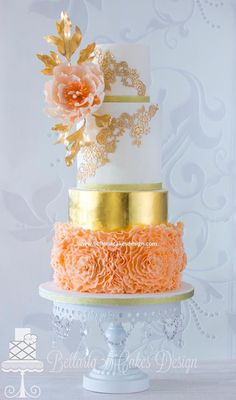 peach ruffles wedding cake with gold leaves