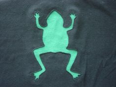 How to make a frog-tshirt with reverse applique - doesn't look too difficult. And the frog is cute.