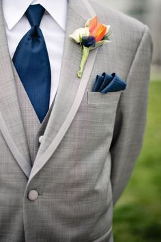 Reverse this: navy suit with grey tie and peach boutonnière